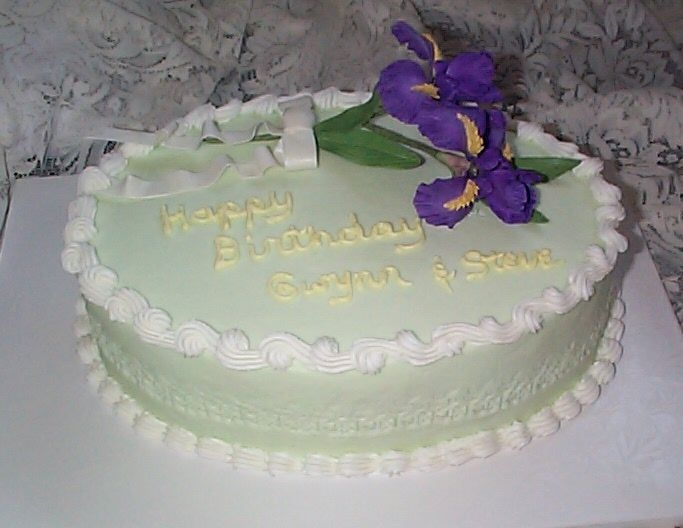 Birthday Cake For Co-Workers Pineapple layers with pina colada filling and coconut buttercream frosting made for the April and May birthdays at work. Gumpaste Irises.