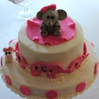 Elephant Baby Shower top layer sugar free yellow cake, bottom layer WASC with buttercream. Fondant Elephant and mouse.
