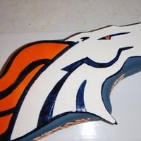 Denver Bronco Cake My first attempt at hand painting a fondant/gumpast plaque....pretty proud of myself.