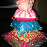 Stack Of Pillows This was a 30th Birthday cake. The pillows are carved out of pound cake and covered in fondant. tassels and balls are gumpaste. Brushed...