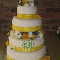 Summer Daisies Wedding Cake Fondant covered cakes with fresh flowers between the tiers and ribbon wrapping the bases