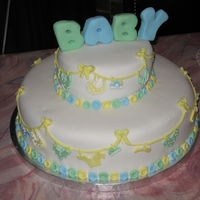 Baby Boy Shower Cake Baby boy fondant shower cake. Baby clothes made with cookie cutters and embellished with royal icing. buttons cut out with back side of #12...