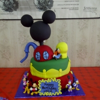 Mickey Mouse Clubhouse 1st Birthday Cake Mickey Mouse Clubhouse. Fondant, gumpaste and rice cereal. Chocolate cake with buttercream frosting covered in fondant....