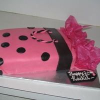 Gift Bag 1/4 sheet white cake w/ choc butter-cream oreo filling. First cake my hubby and I did together & our 1st using fondant. We used the...