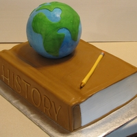 World History Book A cake for my sons world history class I got the idea from LisaCarter thank you. the globe is a styro foam ball covered in fondant. I cut...