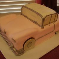 "Pink Cadillac customer surprised co-worker with this ""Elvis Pink Cadillac"" carved cake. Strawberry cake w/strawberry filling. Husbnd helped..."