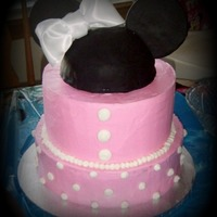 "Minnie Mouse Cake This was a 1st birthday cake for my niece. The ears are black fondant. The hat is a ""smash"" cake."