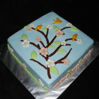 Blooming Birthday Square cake with blue bc. All decorations are fondant and were made using the Wilton Nature Fondant Mold.