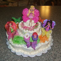 Thumbelina And Friends This may not be my best cake, and no the dolls are not edible, but it always makes me smile when I see it - and since Thumbelina is magical...