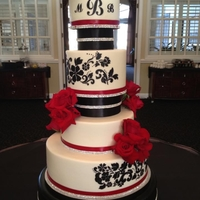 "Red & Black Wedding Cake 6"", 8"", 10"" 14"" cakes iced in buttercream. The 2nd tier is 6"" tall. Floral damask pattern in black with red satin..."