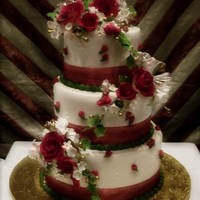 Red Roses Gumpaste bouquets on a buttercream iced cake.