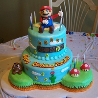 Super Mario Characters are made of fondant. Cake is iced in buttercream.