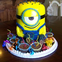 "Minion Cake Made With 8 Rounds And Buttercream Minion cake made with 8"" rounds and buttercream."