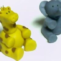 Fondant Giraffe And Elephant  Here is a giraffe and elephant I made out of fondant. I have an order fora circus-themed cake and thought I would do this plus a lion and...