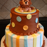 Lion Baby Shower All white cake with a fondant lion. All buttercream with fondant accents.