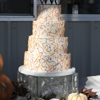 Fall Wedding Was a little worried about this one. But ended up really liking it. They loved it. All white with buttercream. Royal icing for the swirls...