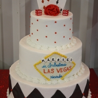 Vegas Wedding Couple got married in vegas. White, chocolate. All buttercream with fondant accents. Gumpaste cards.
