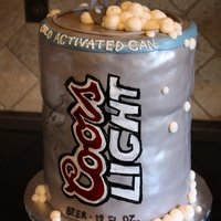 "Coors Light This was a first. Made of 8"" rounds. The fondant was a little hard to do. Handpainted the logo."