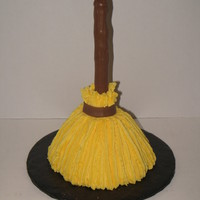 Broom Cake fondant covered dowel, iced in buttercream
