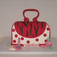 Purse & Make-Up Iced in buttercream with fondant accents.