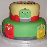 Chuggington Cake Cake for Icing Smiles. Two different tiers of chocolate cake. All fondant work.