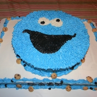 Cookie Monster White sheet cake, chocolate round cake, cookies with Buttercream frosting.