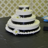 Borrego Wedding White cake, black ribbon.