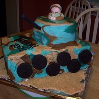 Tank Cake   Buttercream iced with fondant man and oreo wheels
