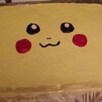 Pikachu My son wanted a cake that looked like his Pikachu Gameboy.