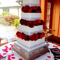 4 Tier Square Buttercream Cake With Fresh Red Roses 4 tier square buttercream cake with fresh red roses.