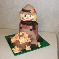 "Scarecrow Cake All chocolate cake (hersheys special dark recipe), body is 4- 8"" oval , head is 2-6"" round, basket is 1-6"" round, hat is a..."