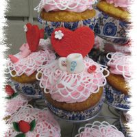 Valentine's Cupcakes For Paramount Coffee  These cupcakes were for my co-workers at a coffee company. The hearts, flowers and mini coffee cups are gum paste, lace is Sugar Dress (...