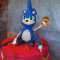 Catching The Rings Sonic is made of RC Treats covered in chocolate molding clay and then gumpaste. The cake is chocolate and BC and gumpaste accents. TFL