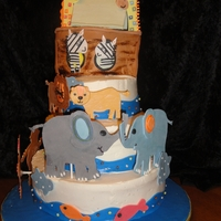 Noah's Journey White, Chocolate and then Marble tiered cake with whipped frosting. Gum paste animals. TFL