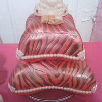 Zebra Print Pillow Cakes Red Velvet And Yellow Cake With Pink Chocolate Genache Filling Toppped With Buttercream And Fondant Crown And Baby... zebra print pillow cakes red velvet and yellow cake with pink chocolate genache filling toppped with buttercream and fondant crown and baby...
