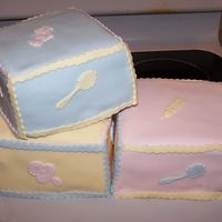 Baby Blocks  Made for my nieces shower. square cakes stacked tall to make blocks, then covered in fondant. Trim is fondant cut with a rigged edge cutter...