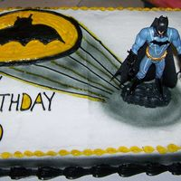 Batman Toy Cake airbrushed shadow/light, piping gel colored for emblem, batman toy on BC