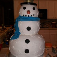 Snowman Stands 21/2 feet tall without his hat. Bottom layer is red velvet, middle is chocolate and head is lemon. All covered in fondant.