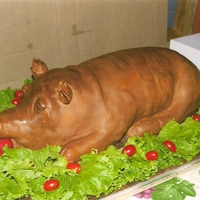 Luau Pig Roast This was a roasted pig cake presented to a friend at his retirement party which was a luau. He was actually the one being roasted.