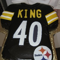 40Th Birthday Cake 4/9/11Vanilla cake with chocolate fudge icing (tinted black) and Steelers logo edible image. the letters are yellow vanilla chocolate and...