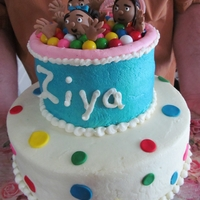 Gym Ball Pit With Kids Two tier vanilla cake with vanilla buttercream and fondant figures.