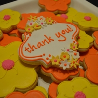Thank You Cookie Platter Yellow & Orange blossom flowers with a Thank You plaque. Fondant flowers on the plaque and fondant flower centers. NFSC recipe with...