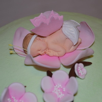 Cherry Blossom Baby Shower Cake Mint green buttercream with pink cherry blossoms. The baby was made with a mold, but I added the wings, diaper and headband.