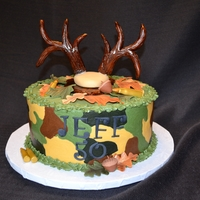 "Camo Cake For A Deer Hunter   Camo design made in buttercream, fondant/tylose antlers, leaves, acorns & rifle shells. 10"" round."