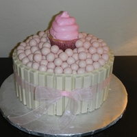 Kit Kat Cake With Smash Cupcake   WASC cake covered in cream cheese frosting wrapped with kit kat's and a smash cupcake