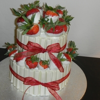 Kit Kat Strawberry Basket   strawberry cake, cream cheese frosting covered in white kit kate and filled with white chocolate dipped strawberries TFL!