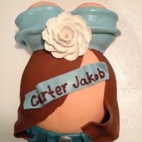 Pregnant Belly Cake   Fondant covered cake with gumpaste flower