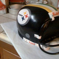 Superbowl Cake Packers/steelers   Packer/Steeler helmet, red velvet wasc, fondant, and face mask out of bendable wire from homedepot.