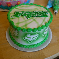 Green Fox Racing WASC with buttercream. Fox Logo is painted fondant, designs are airbrushed.