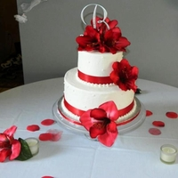 "Bruno Wedding 6"" & 10"" strawberry marble cake iced and filled in all butter cream. Silk flowers and satin ribbon around each tier. TFL"